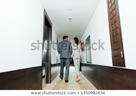 businesswoman holding hand out stock photo © photography33