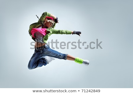 cool woman dancer jumping in mid air stock photo © feedough