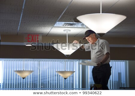 Inexperienced electrician with bulb Stock photo © photography33