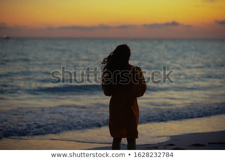 Silhouette girl on seacoast Stock photo © kash76