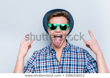 young man tongue out stock photo © feedough
