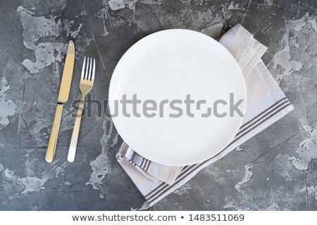 Fork, knife and empty white plate stock photo © karandaev