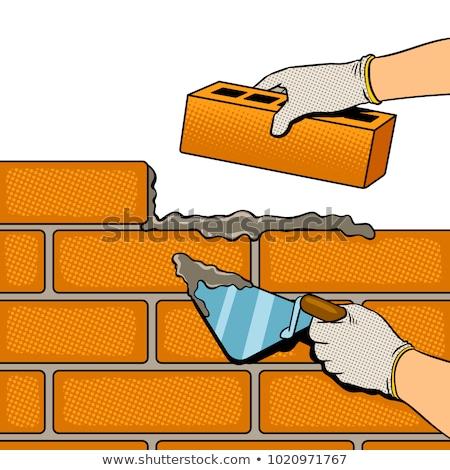 Brick wall and trowel  Stock photo © Ciklamen