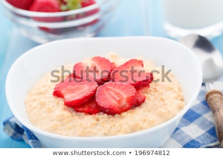 bowl of muesli and strawberry porridge stock photo © m-studio