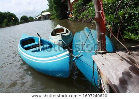 three plastic canoe stock photo © smuki