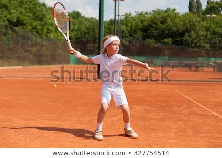 boy in tennis lesson stock photo © meinzahn