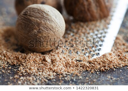 Nutmegs and grater Stock photo © MKucova