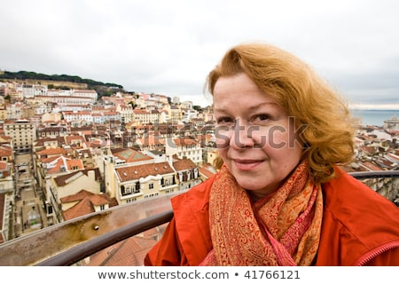woman is looking friendly and happy at a scenic point in the old Stock photo © meinzahn