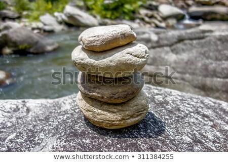 isolated stacked zen stones near seashore stock photo © stockyimages