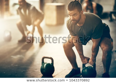 Man training with dumbbells on white Stock photo © Elnur