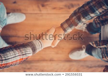 View stringere la mano holding hands Foto d'archivio © zzve