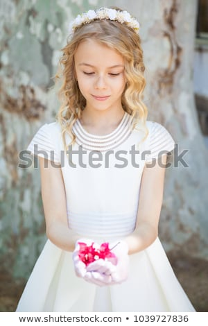 Happy young girl in her First Communion stock photo © BigKnell