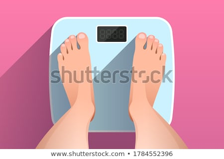 pregnant woman standing on bathroom scales stock photo © highwaystarz