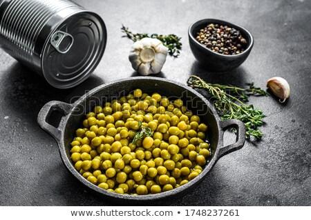 Dobozos zöldborsó étel fa konyha asztal Stock fotó © yelenayemchuk