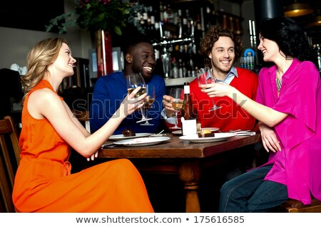 Friends raising their glasses in a toast Stock photo © d13