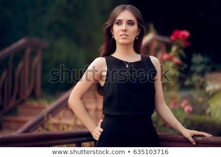 Portrait of Young Woman in Sleeveless Dress Stock photo © gromovataya