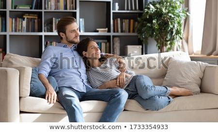 Felice Coppia divano guardando distanza Foto d'archivio © juniart