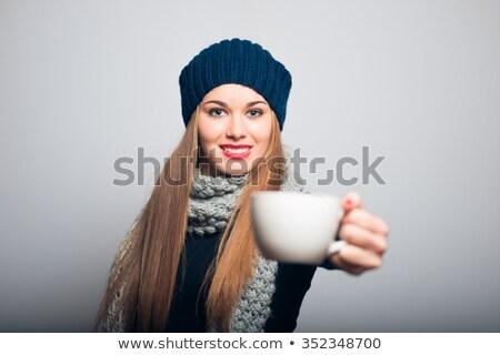Güzel kırmızı kız sıcak içecek kupa yalıtılmış Stok fotoğraf © feverpitch