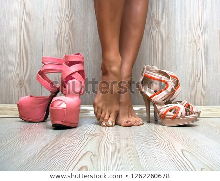 Beautiful woman legs standing in red shoes with high hills  Stock photo © deandrobot