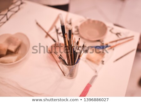 Earthen dishes made by potter on the table Stock photo © deandrobot