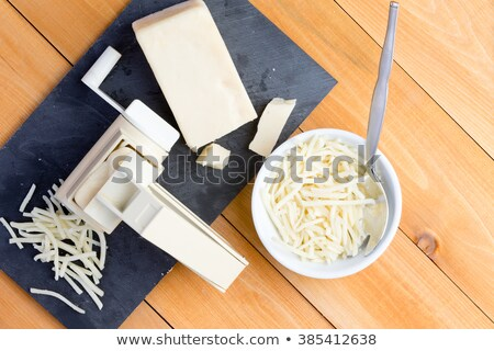 preparing grated gruyere cheese for cooking stock photo © ozgur