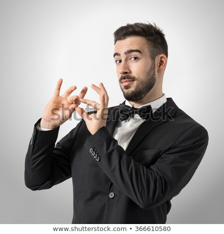 Happy businessman holding engagement ring Stock photo © deandrobot