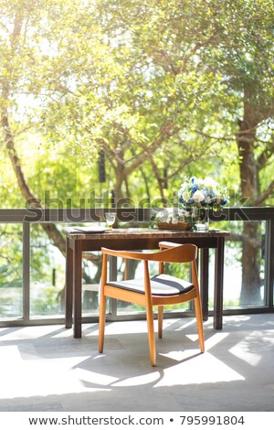 a newspaper on a wooden desk   house and garden stock photo © zerbor