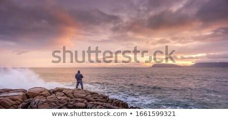 Vad út naplemente gyönyörű tengerparti kövek Stock fotó © morrbyte