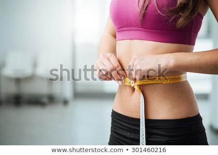 ölçmek · ölçek · bronzlaşmış · ince · genç · kadın - stok fotoğraf © restyler