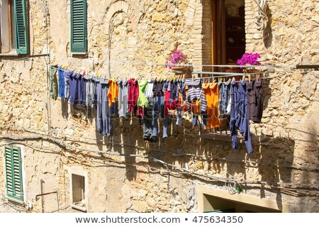 Laundry drying on clothes lines in the street of Volterra Stock photo © Digifoodstock