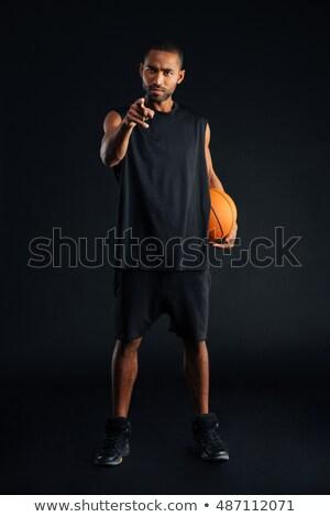 концентрированный · серьезный · африканских · спортивных · человека · указывая - Сток-фото © deandrobot