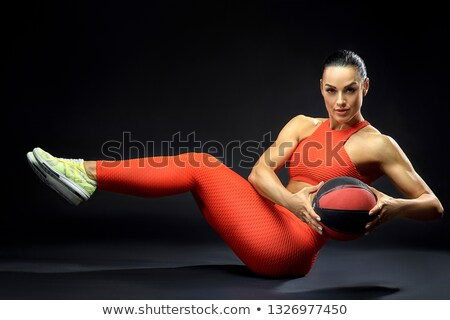 beautiful fitness woman holding red ball and looking at camera stock photo © deandrobot