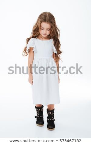 Smutne zmęczony dziewczynka spaceru patrząc w dół Zdjęcia stock © deandrobot