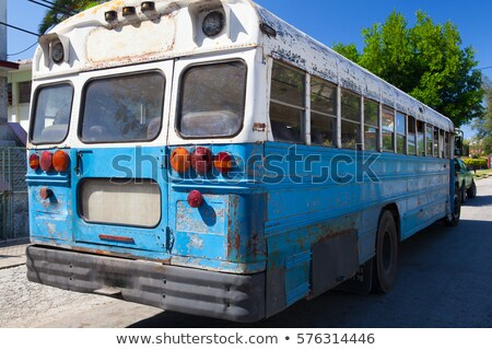 typical old school bus parked on the havana street cuba stock photo © capturelight