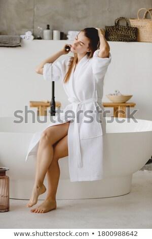 függőleges · kép · fiatal · nő · fürdőköpeny · néz · kamera - stock fotó © deandrobot
