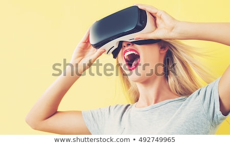 Stok fotoğraf: Blonde Girl Using Vr - Virtual Reality Headset