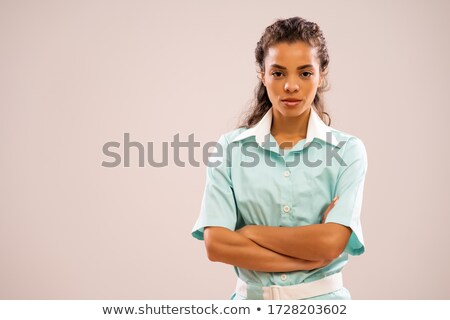 Pensive young nurse in uniform thinking and looking at camera Stock photo © deandrobot