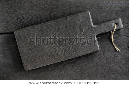 black cutting board Stock photo © Digifoodstock