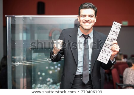 Man winnend loterij ticket opgewonden glimlachend Stockfoto © monkey_business