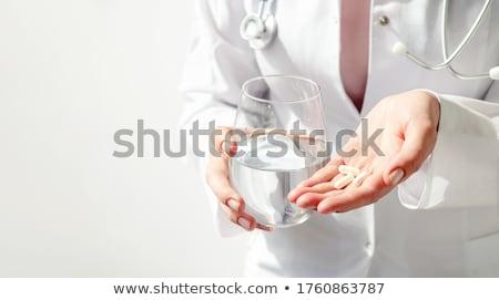farmacêutico · pílulas · vidro · água · jovem - foto stock © rastudio