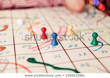 close  up of snakes and ladders board stock photo © monkey_business