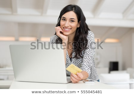Portrait of a woman doing bills Stock photo © IS2
