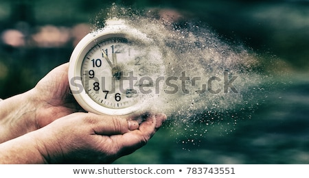 Time is passing, female hand with vintage alarm clock Stock photo © stevanovicigor