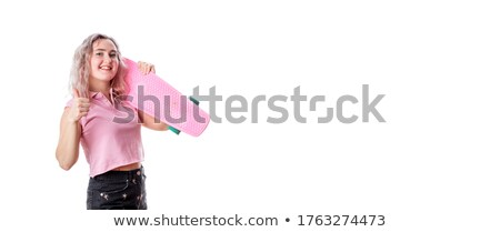 Young lady posing on skateboard idolated over pink Stock photo © deandrobot