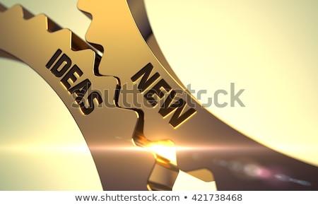 new ideas on golden metallic cogwheels stock photo © tashatuvango