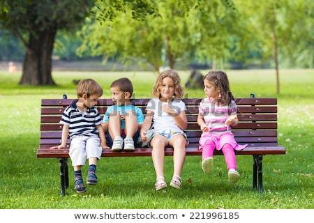 gyermek · ül · pad · vissza · az · iskolába · boldog · aranyos - stock fotó © is2