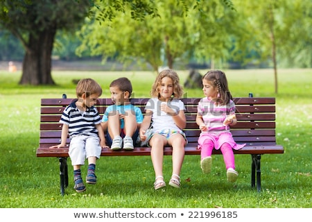 Bambini seduta panchina natura bambino libertà Foto d'archivio © IS2