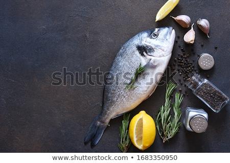 Fresh raw dorado fish on black background, top view Stock photo © yelenayemchuk