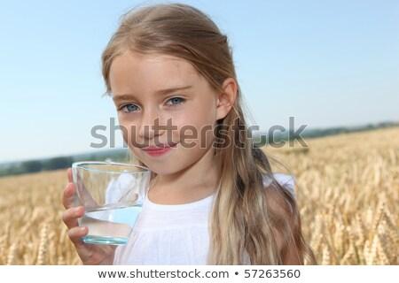 Lány locsol búzamező jókedv kék ég törődés Stock fotó © IS2