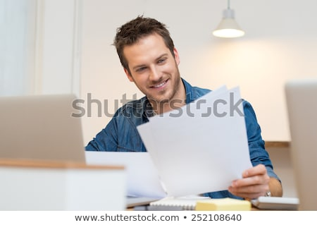 Man reading a paper in the office Stock photo © IS2